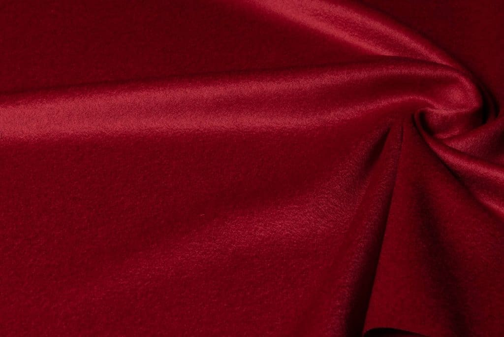100% cashmere fabric in red color
